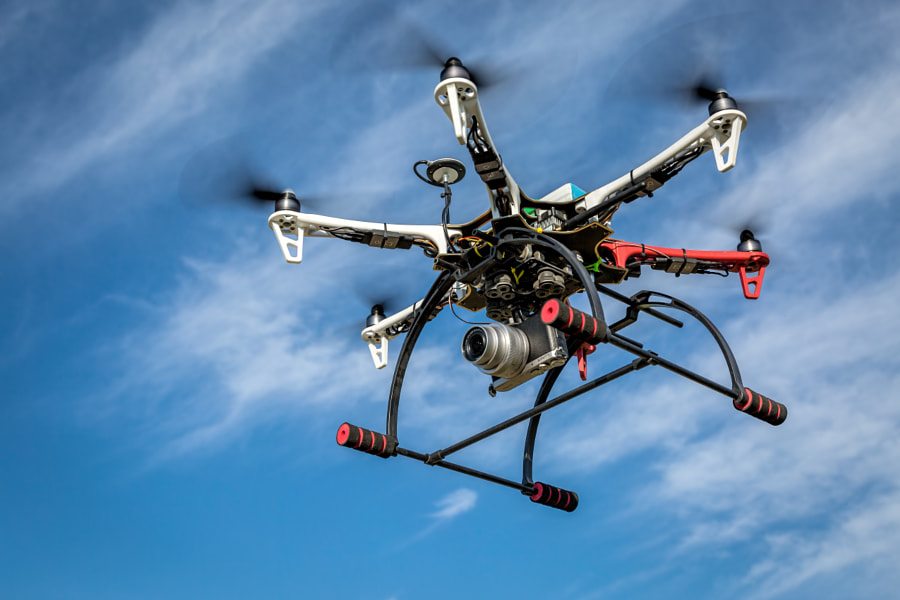 airborne hexacopter drone carrying camera by Marek Uliasz on 500px.com