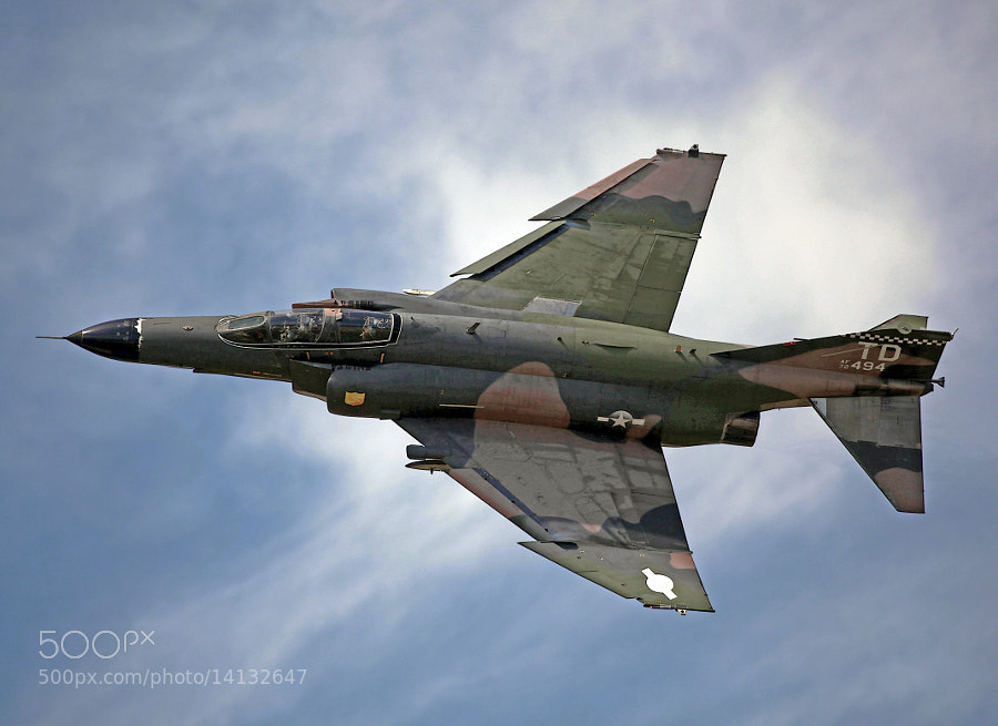 This QF-4E was delivered during the Vietnam War.  Following two decades of service it was flown into retirement at Davis-Monthan Air Force Base and placed in long term storage.  This airframe was later pulled from storage and converted to a remote controlled target.  It was photographed being flown by a pilot in the front seat at the 2012 NAS Oceana Air Show.