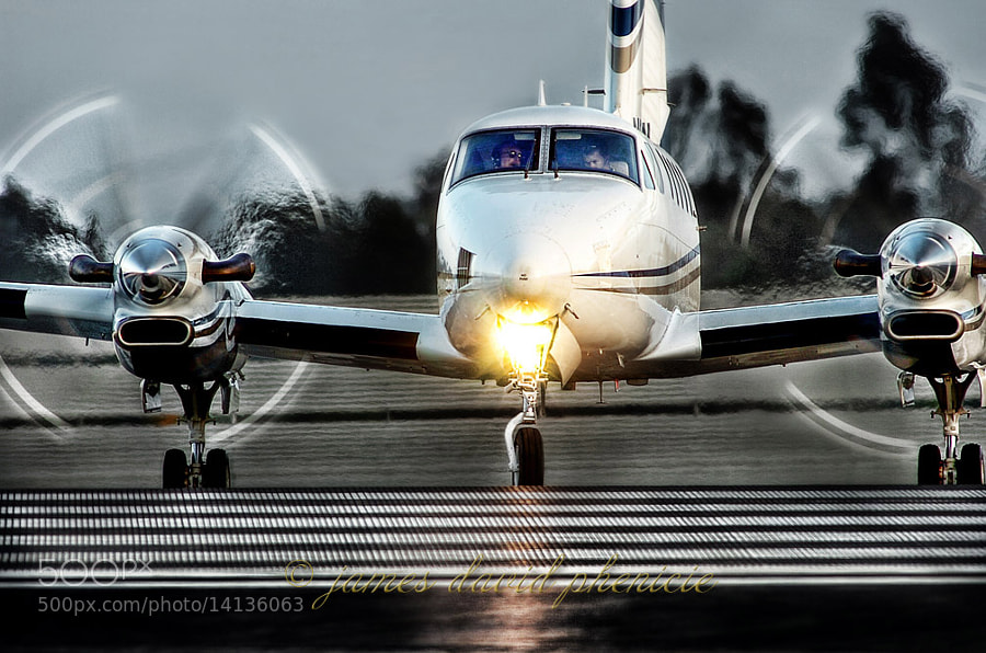 King Air airplane waiting at end of runway for takeoff clearance.   © James David Phenicie.  All Rights Reserved.