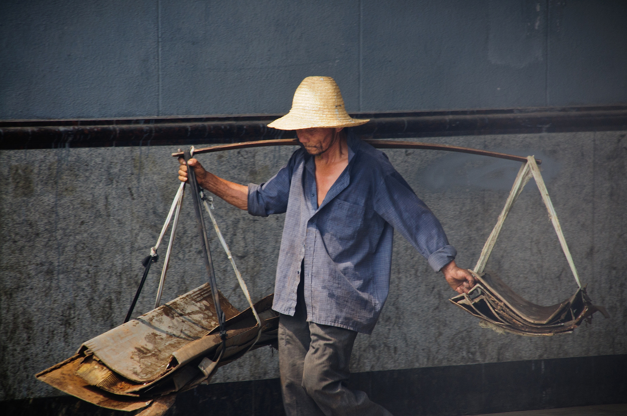 Photograph A worker in China by Steven Kersting on 500px