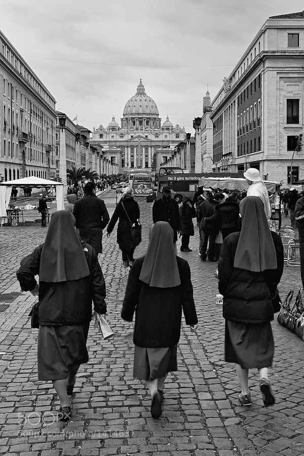 Three nuns make their way to St Peter's Square, Rome to hear a papal address