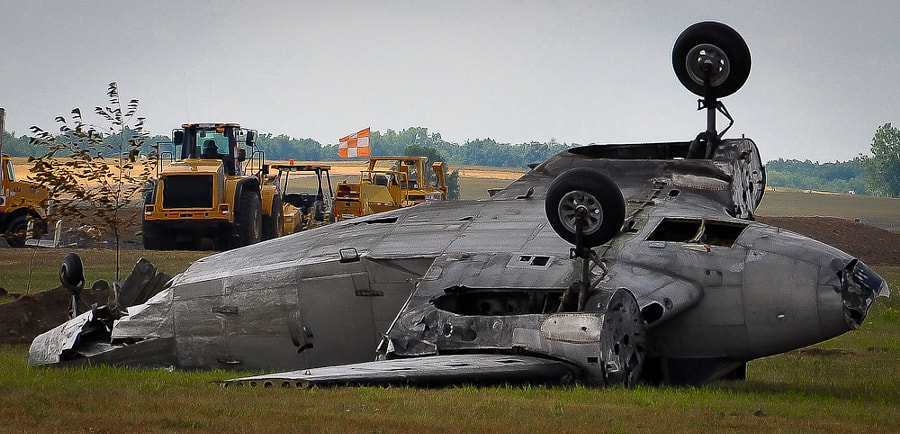 A trashed plane used in a reenactment of a World War 2 battle at Willow Run Airport during 2012 Thunder Over Michigan.