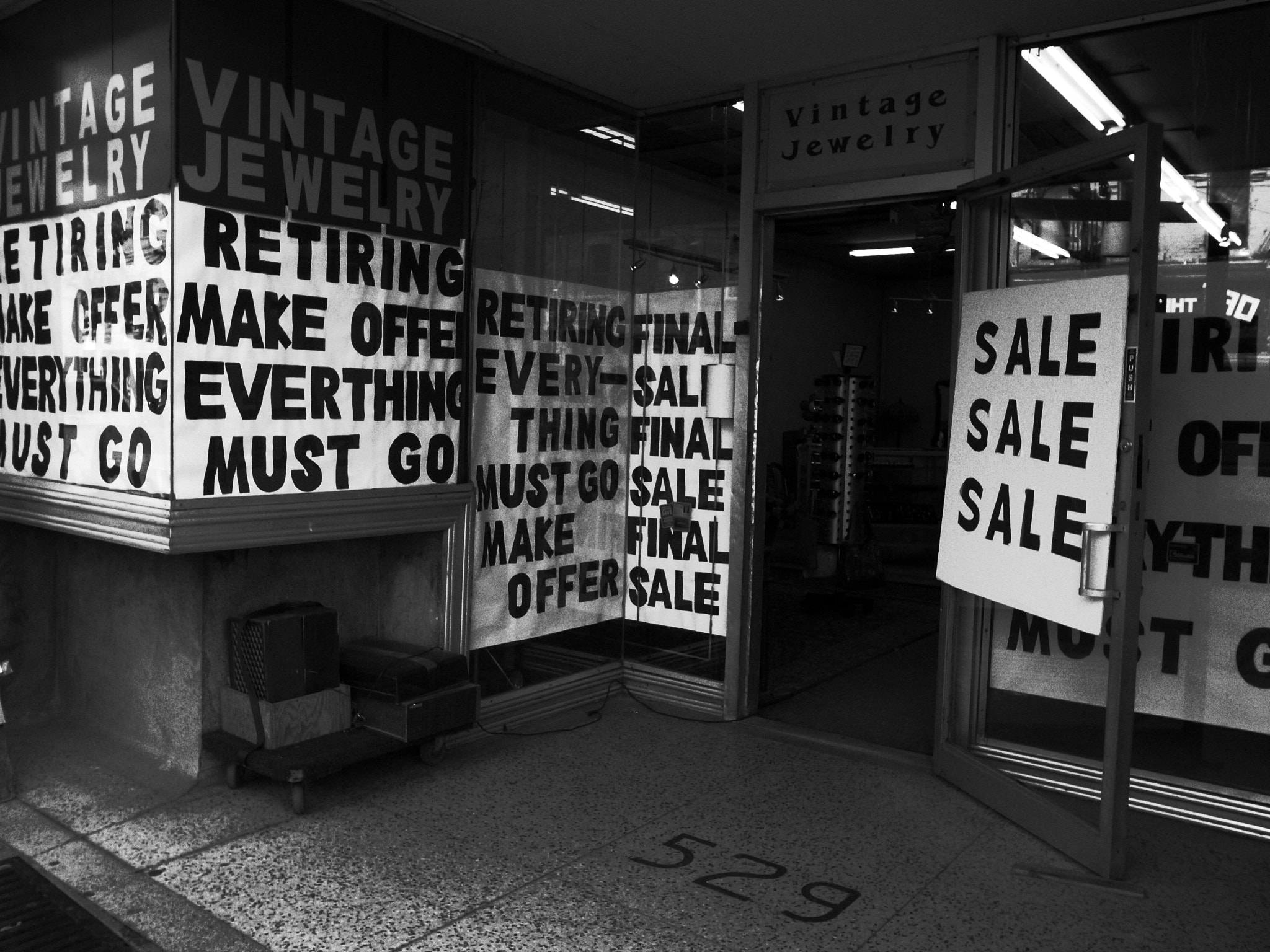 Photograph Retirement Sale Craziness by Simon Carr on 500px