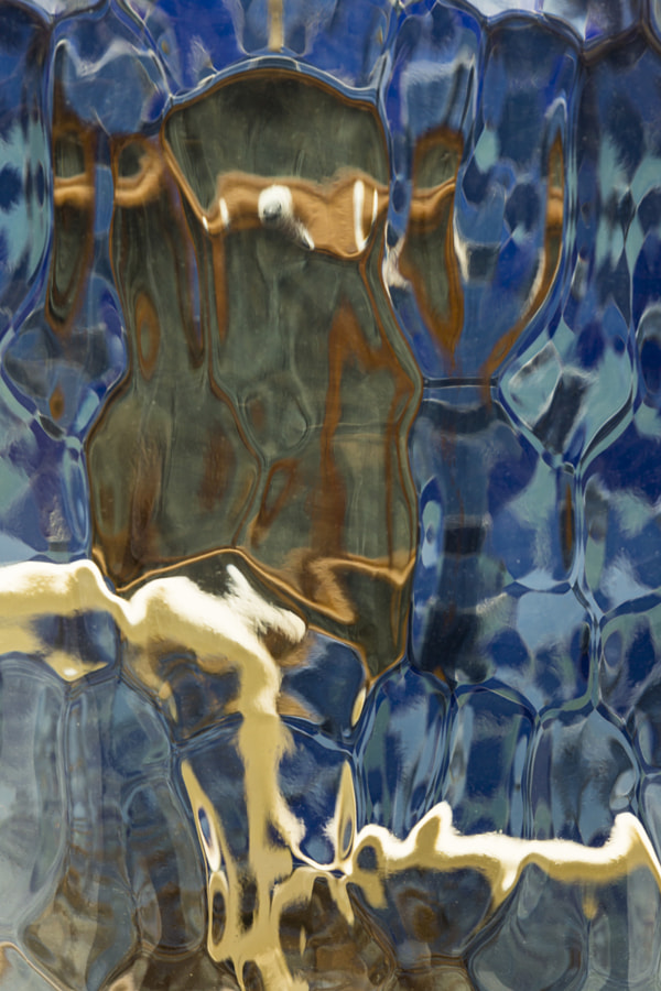 Casa Batllo distorted through glass