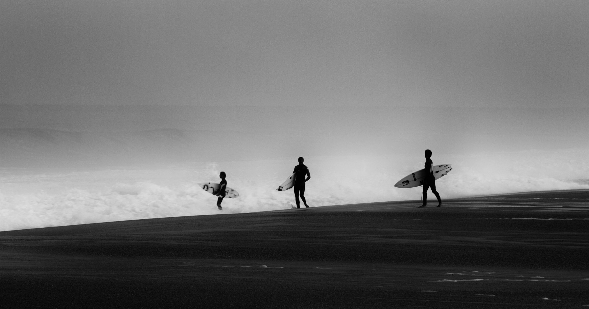 Photograph Black and white surfers by Gauthier Le Guen on 500px