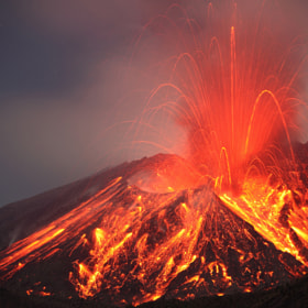 Powerful explosive eruption throws lava high in air during the night, Sakurajima Volcano by Richard Roscoe on 500px.com