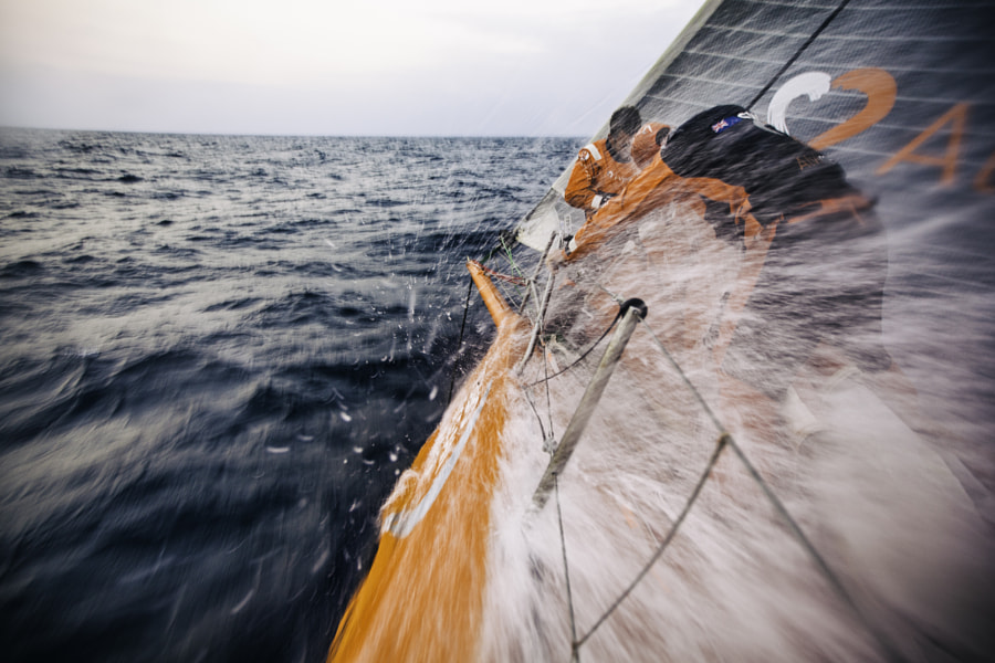 Nick Dana and Dave Swete on the bow of the Team Alvimedica yacht during the Volvo Ocean Race. by Red Bull Photography on 500px.com