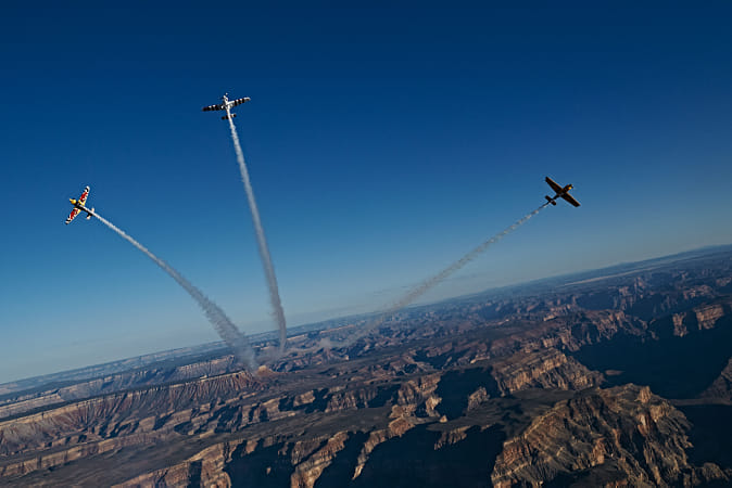 Paul Bonhomme, Peter Besenyei, and Matt Hall fly over the Grand Canyon for the Red Bull Air Race... by Red Bull Photography on 500px