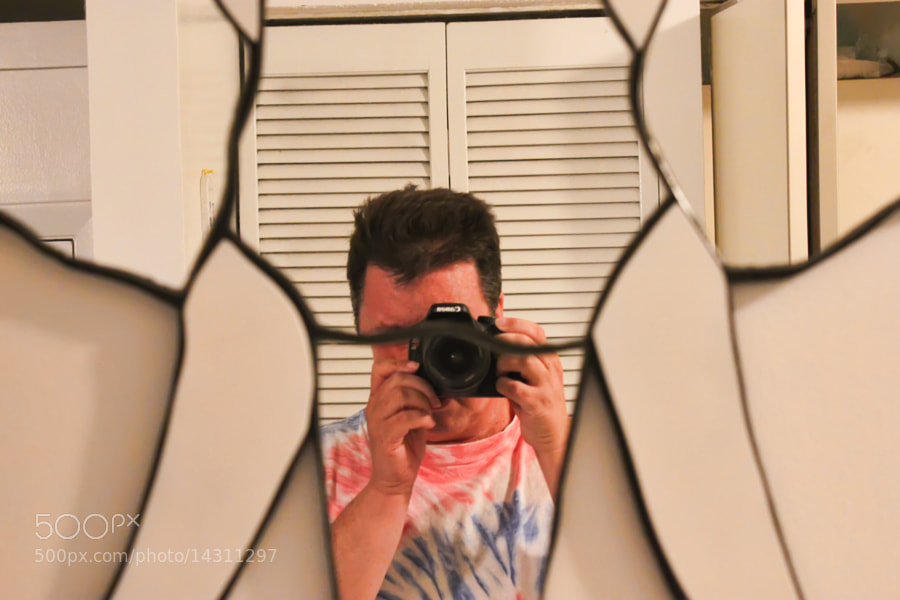 One of my first self-protraits with my DSLR. My Mrs loves elephantts, we have an elephant shaped mirror in our hallway.