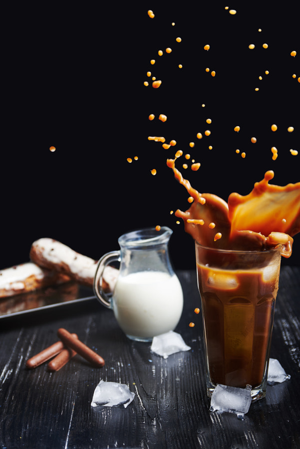 Cold coffee drink with ice and splashes by Viktoriya Faion on 500px.com