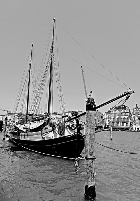 Photograph An old sailboat in Venice in black and white by Ragnar Gjemmestad on 500px