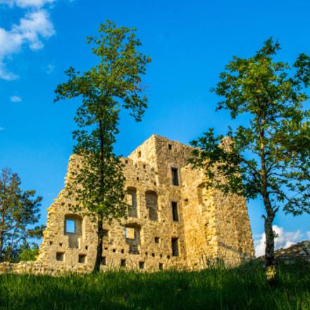 Sun bathed remains of castle