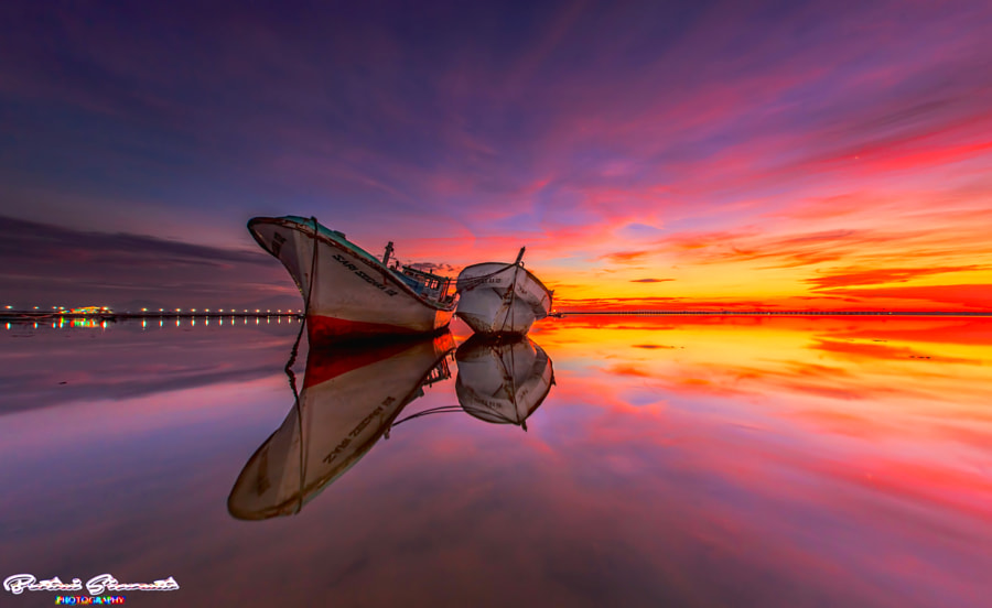When a Couple on Red Sky by Bertoni Siswanto on 500px.com
