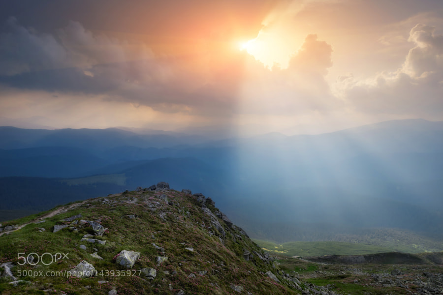 Carpathian Mountains. The rays breaking through the clouds by architecturalphotographer