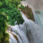 We visit this waterfall on my North Vietnam tour each year.  The waterfall is on the Chinese border in a remote province.  On this occasion a lone fisherman was trying to catch fish for dinner.