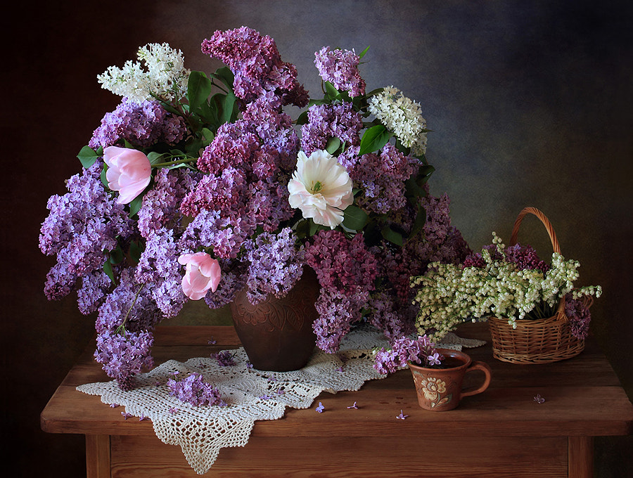 With a bouquet of lilac and Lily of the valley, автор — Tatiana Skorokhod на 500px.com