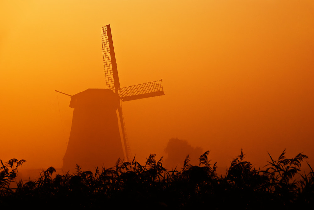 "Photograph ""And Here Is Today's Weather Forecast: Sunny, Misty And An Occasional Poldermill"" by Allard Schager on 500px"