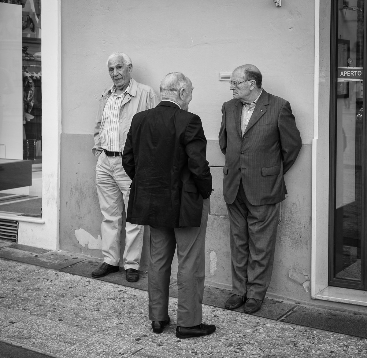 Photograph Three men in a street by Michael Avory on 500px