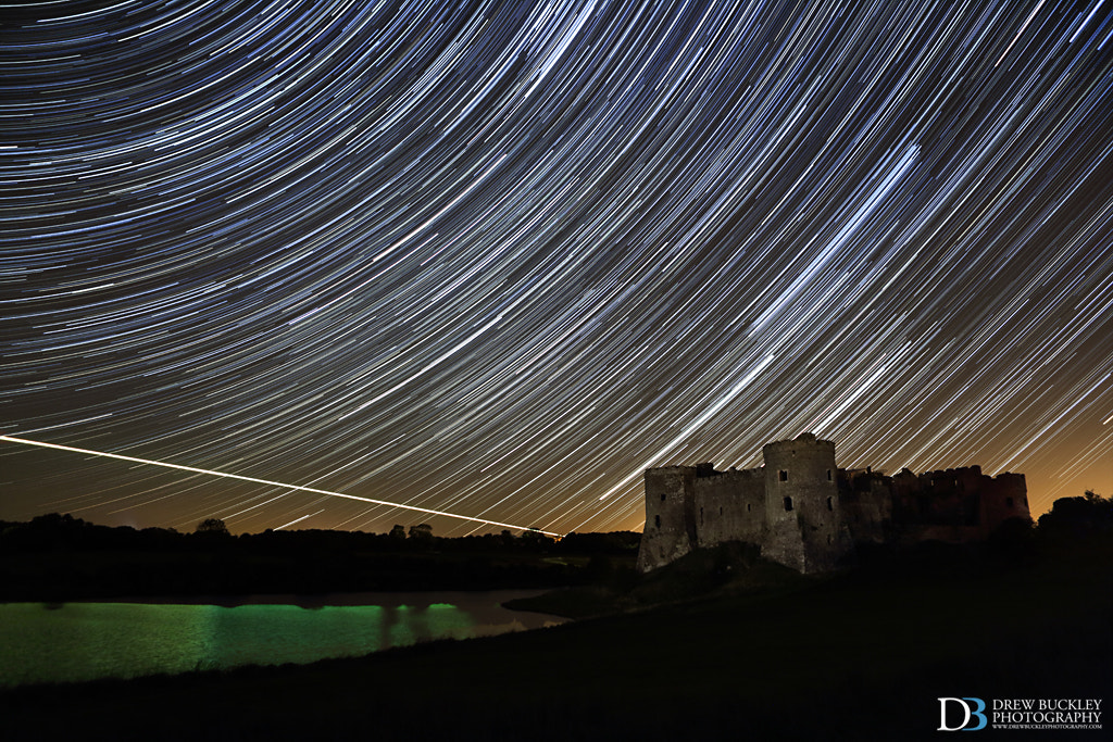 Photograph Carew Castle Star Trails with Fireball by Drew Buckley on 500px