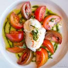 Heirloom tomato salad with burrata and pesto.