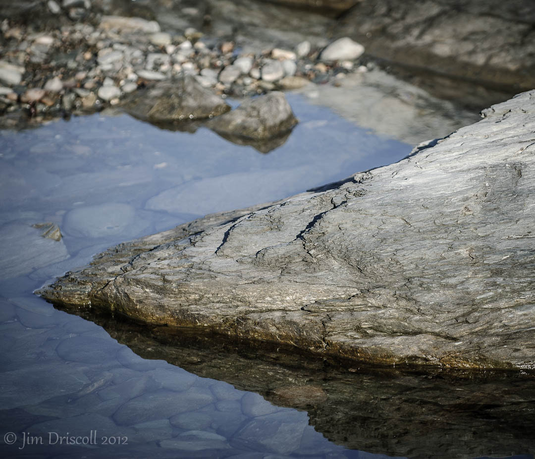 Photograph Stone above and below water by Jim Driscoll on 500px