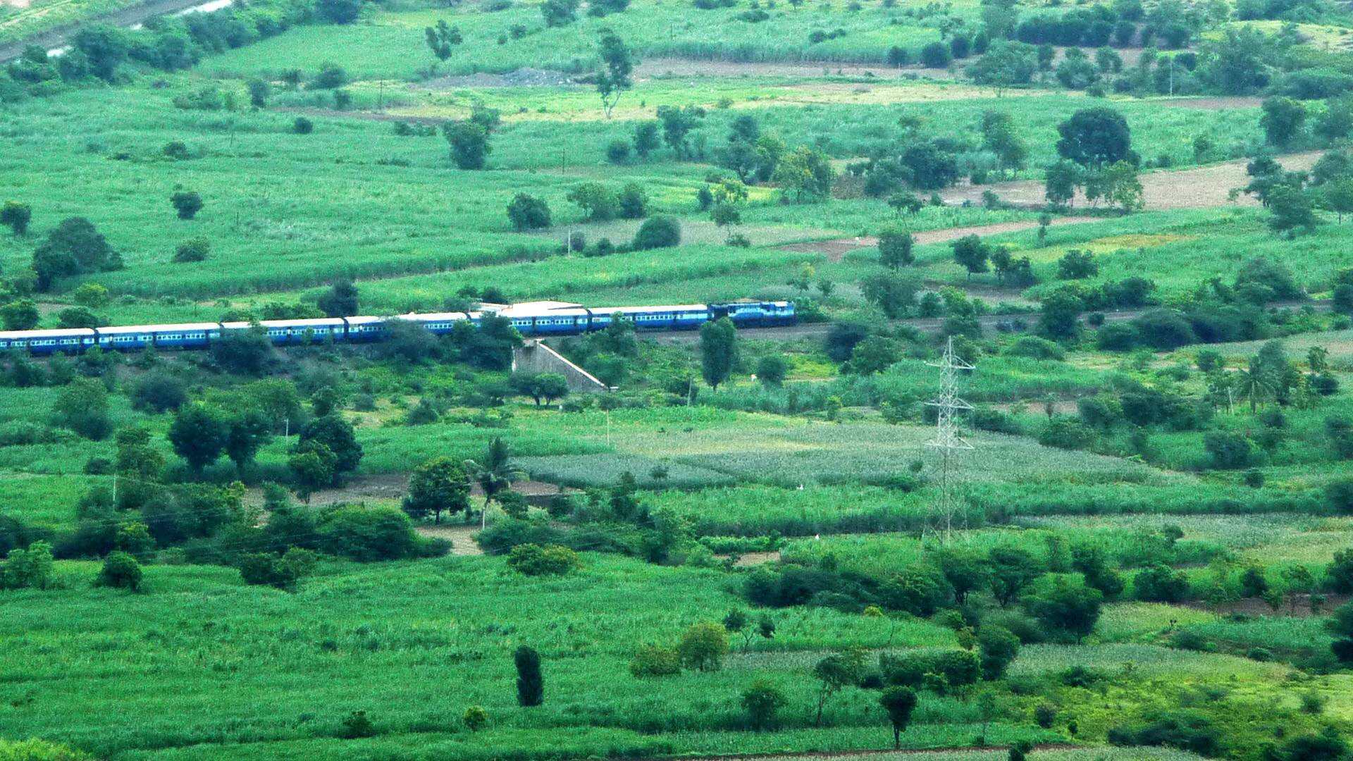 Photograph Train through farms by Mohit Yadav on 500px