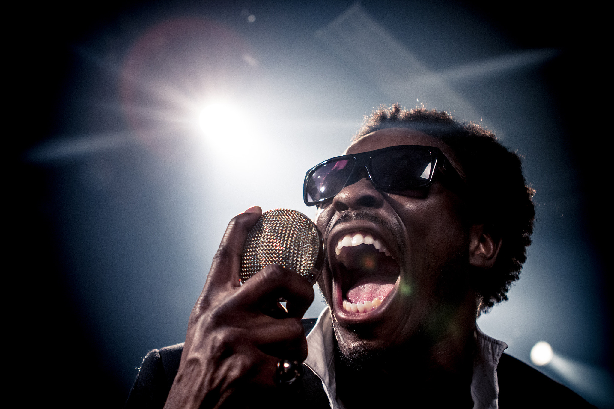 Photograph Chima on the mic by Garrett Gibbons on 500px