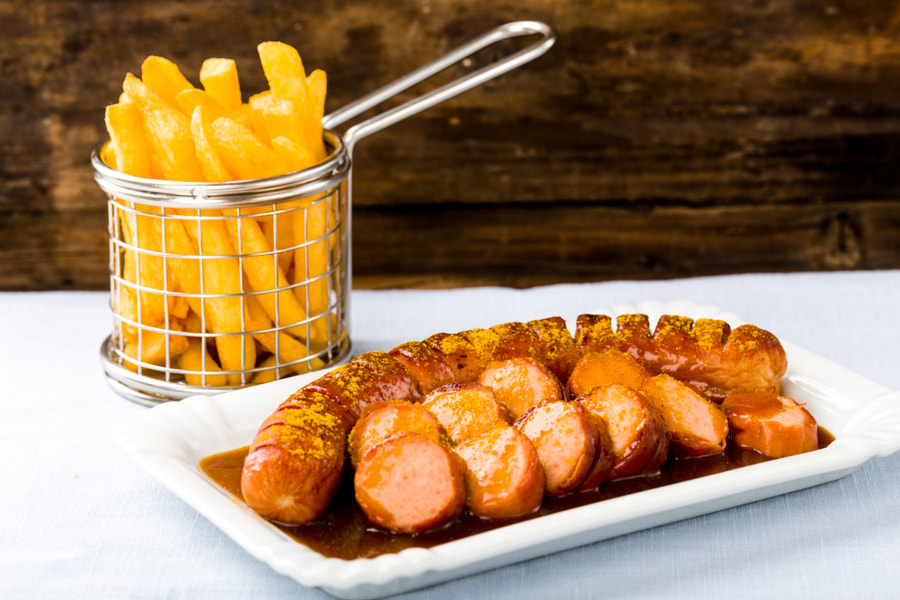 Currywurst with french fries by Christian Fischer on 500px.com