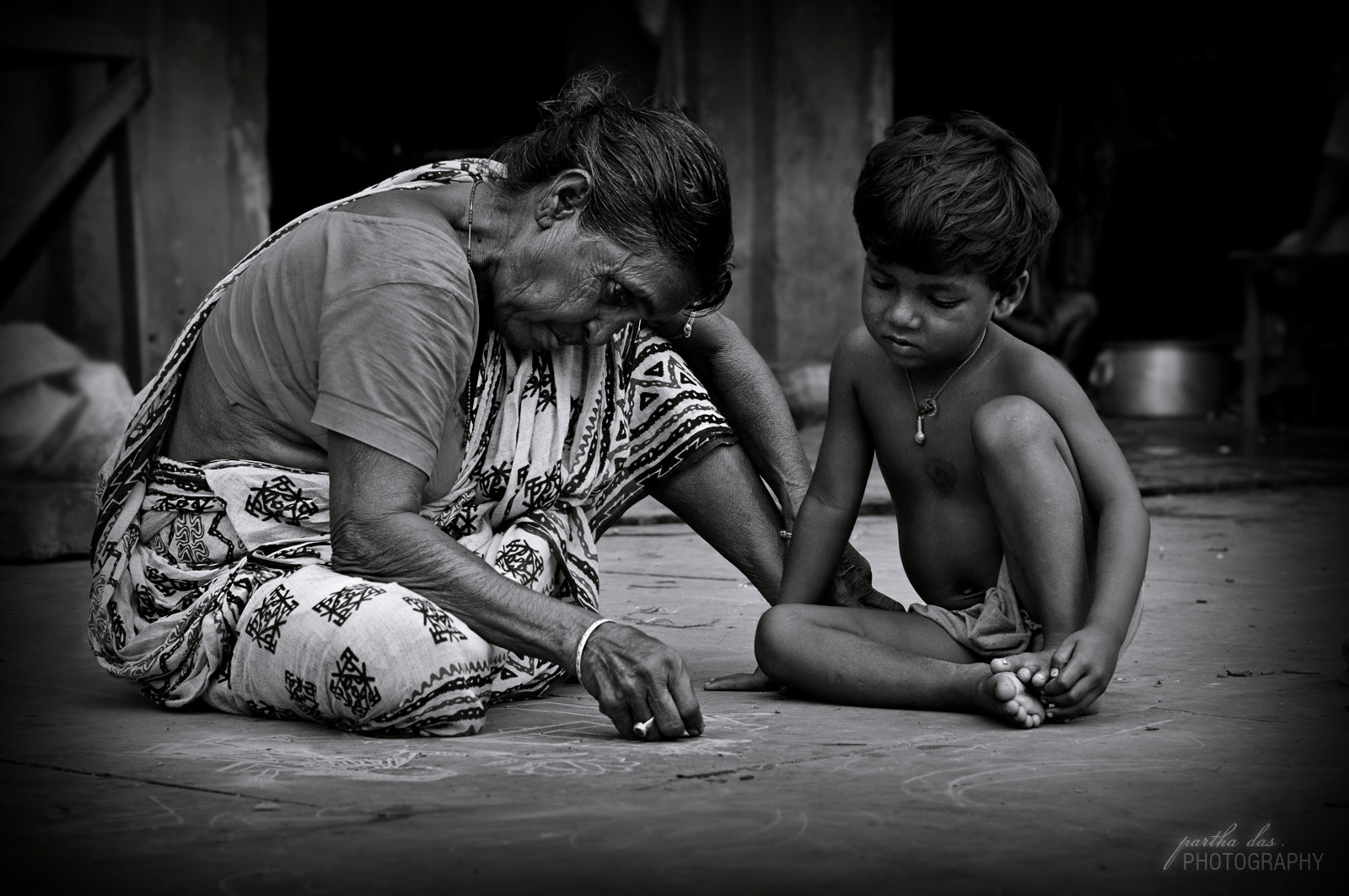 Photograph teaching her to draw... by Partha Das on 500px
