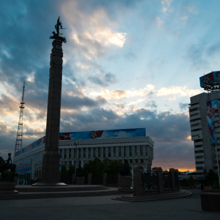 Issyk golden man in the lights of god rays, Almaty