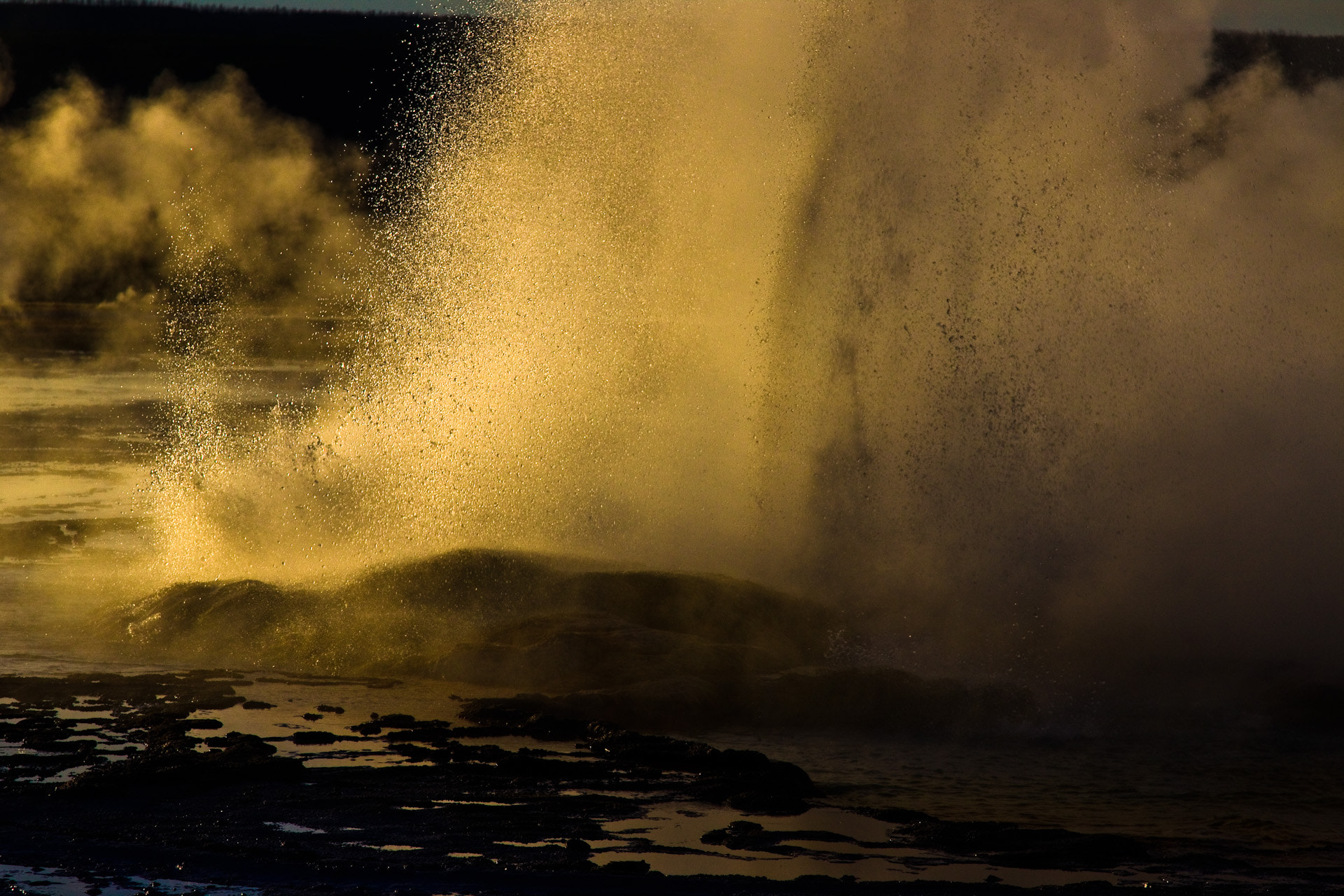 Photograph Geyser Erupting at Sunset in Yellowstone by Michael Riffle on 500px