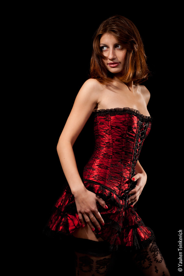 Photograph A girl in red corset by Yauhen Tsinkevich on 500px