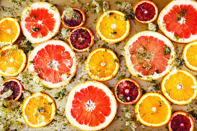 Ripe red oranges and grapefruits cut by rings by Heather Balmain on 500px