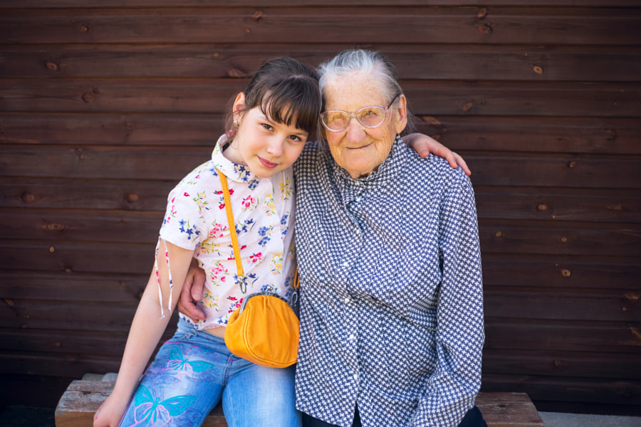 Great-grandmother, and great-granddaughter sitting arm  in arm. by ??????? ?????????? on 500px.com