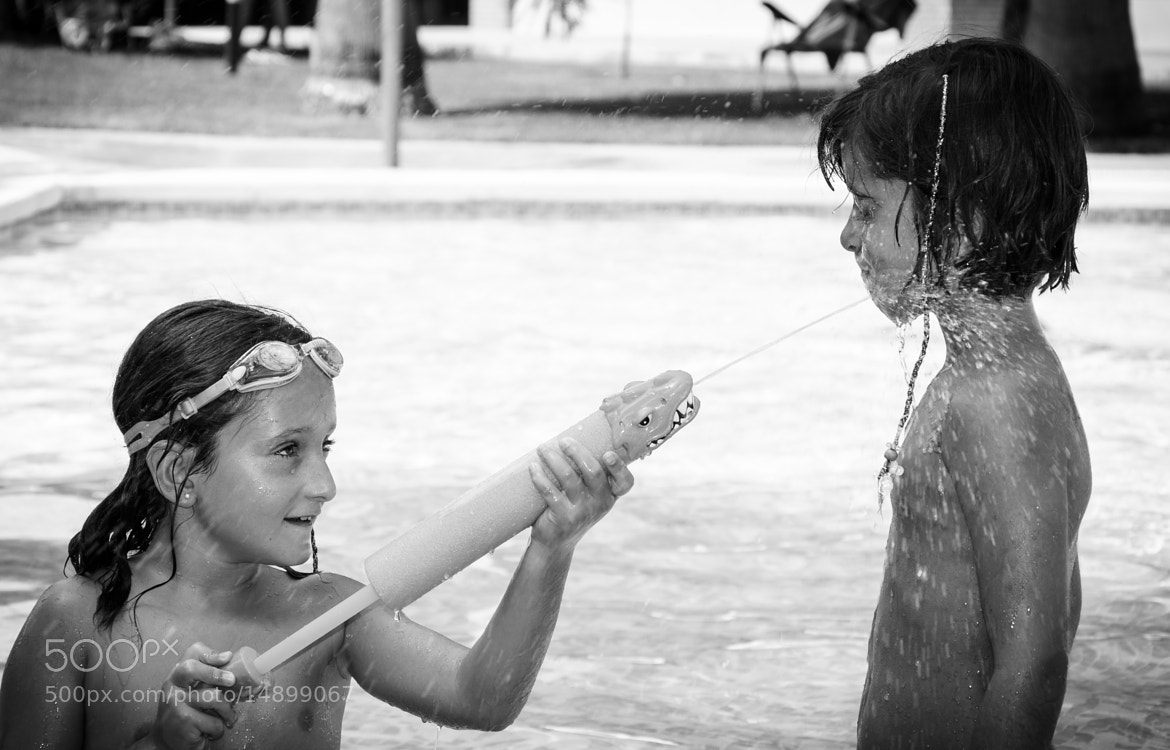 Photograph Kids Playing with Water Guns by Enrico Maria Crisostomo on 500px