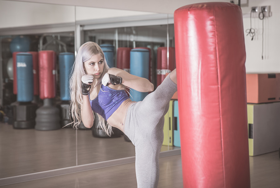 Fighter woman hits the heavy bag by Cristian Negroni on 500px.com