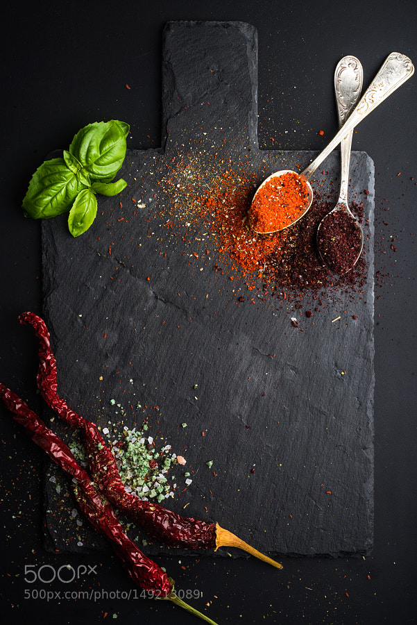 Pic Herbs And Spices On Black Slate Stone Board Over Dark