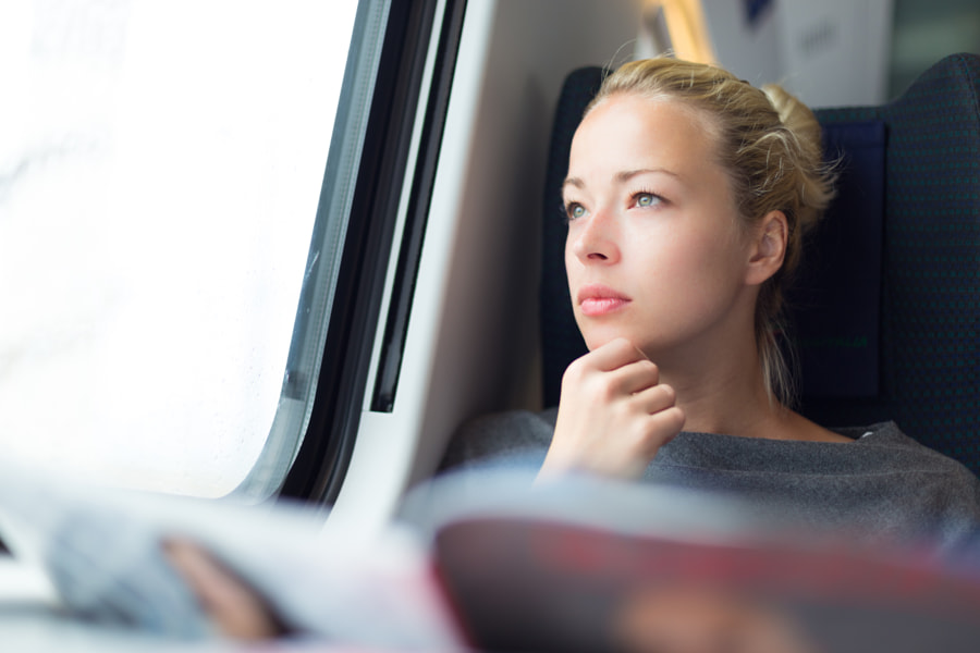 Lady traveling by train. by Matej Kastelic on 500px.com