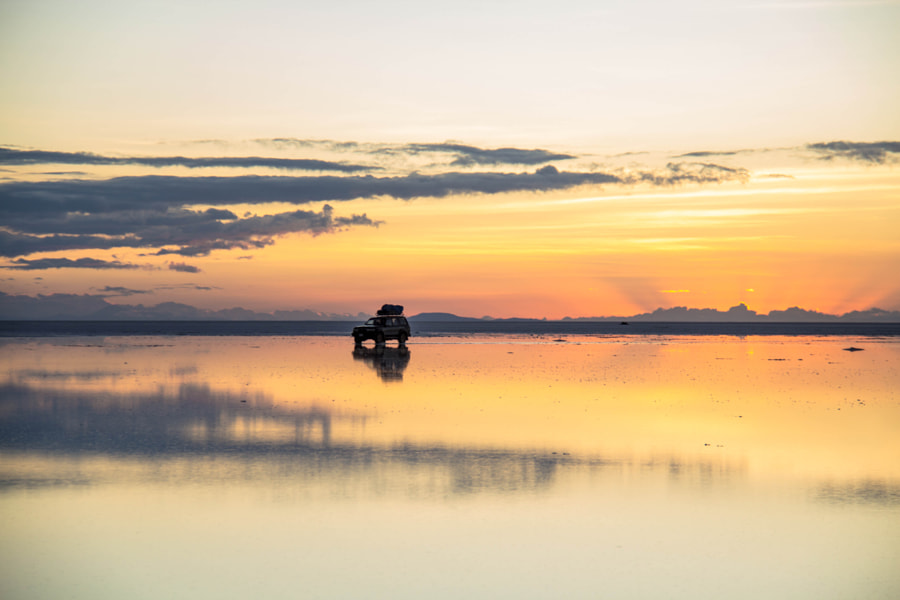 Sunrise driving at Salar de Uyuni by Bastien Poux on 500px.com