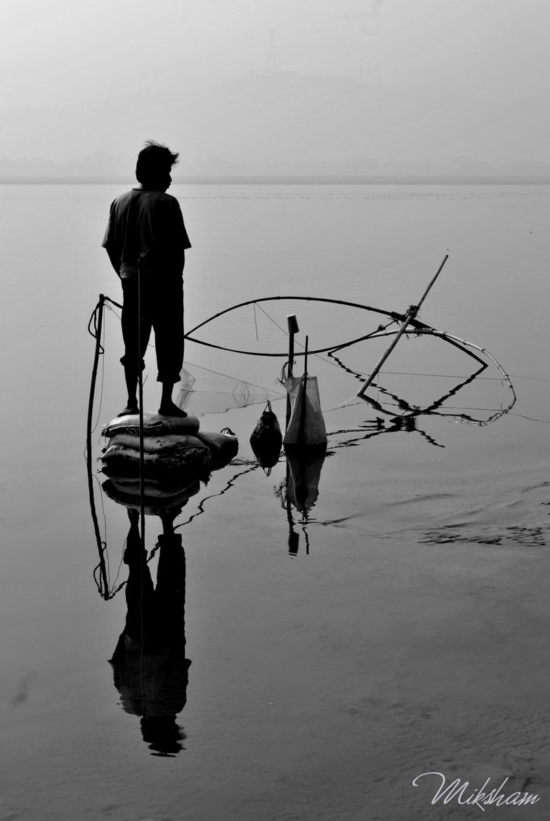 Photograph Silent watcher in the silent waters  by Miksham Lal on 500px