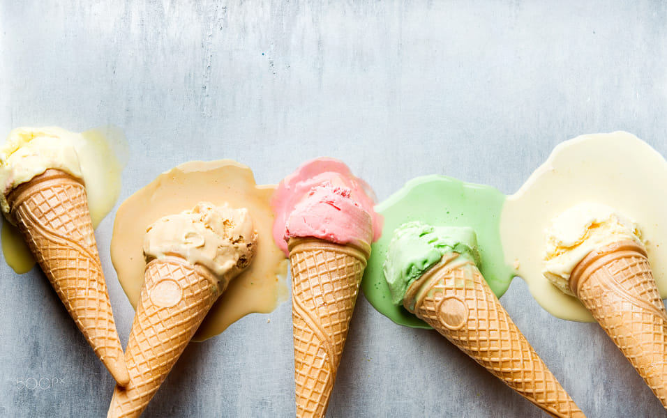 Colorful ice cream cones of different flavors. Melting scoops. Top view,  steel metal background by Heather Balmain on 500px