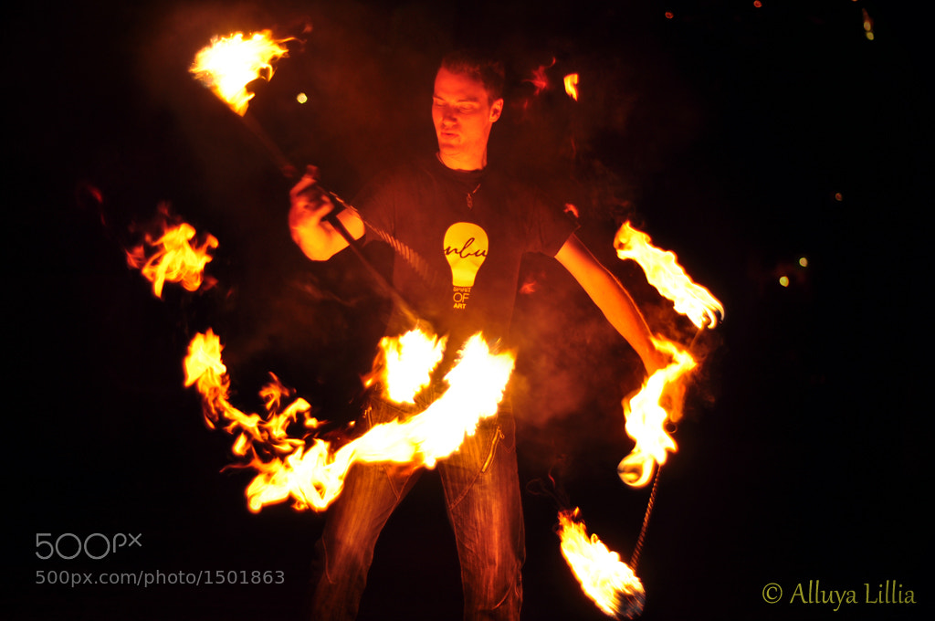 Photograph Fire staffs with fire poi by Alluya Lillia on 500px