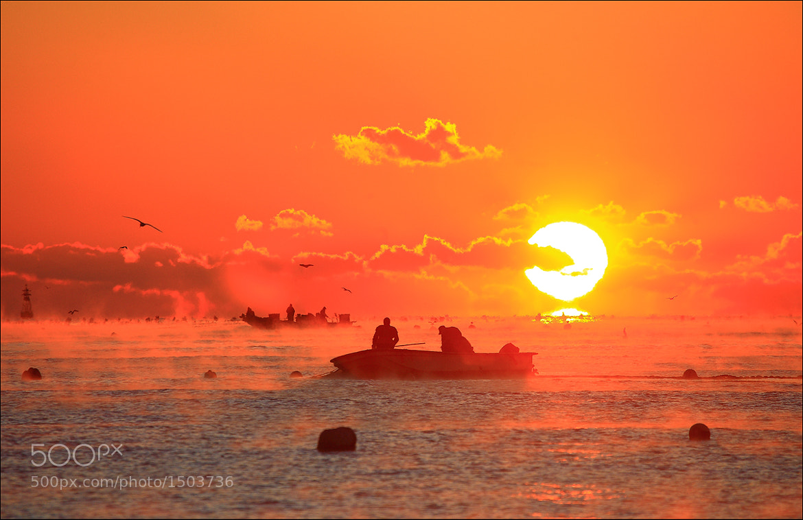 Photograph Sunrise in the two fishermen by keehwan Kim on 500px