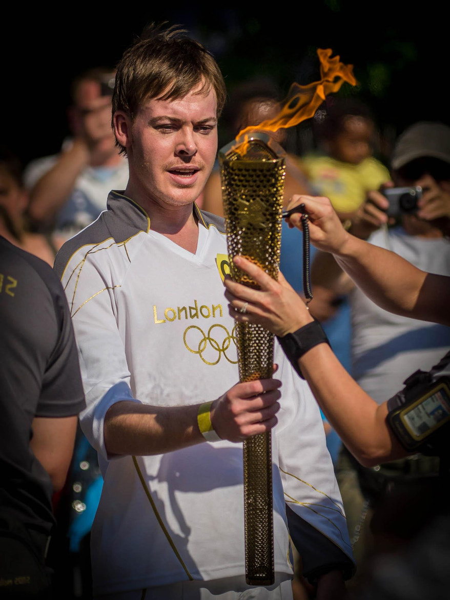 Photograph Matthew Skinner carries the Olympic Torch through Newport.  by Hugh Jones on 500px