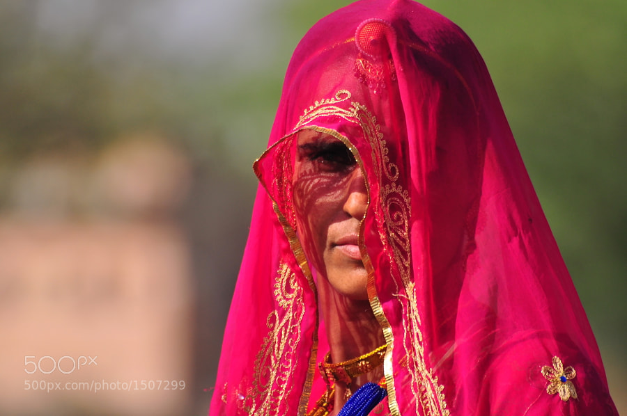 Travelling around Rajasthan cities I've found this woman with her beautiful traditional clothes and mysterious sight...