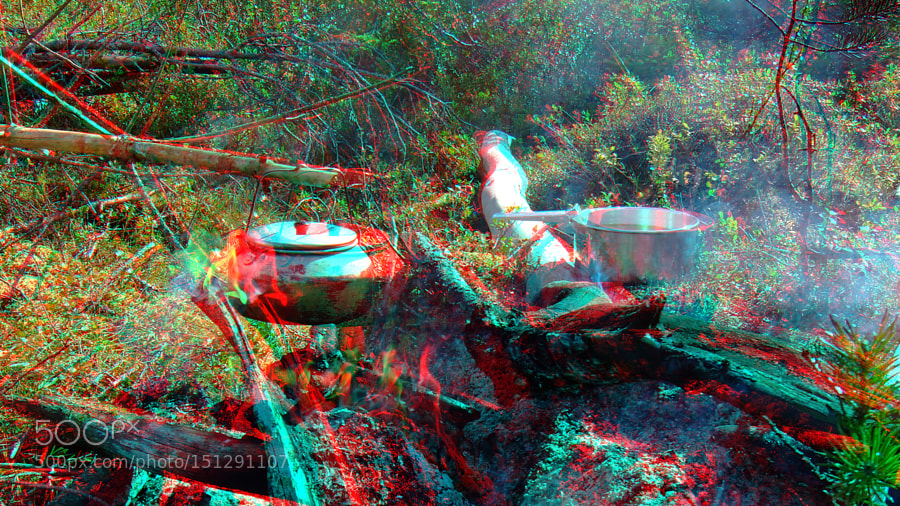 (3D) Making coffee on open fire in wilderness