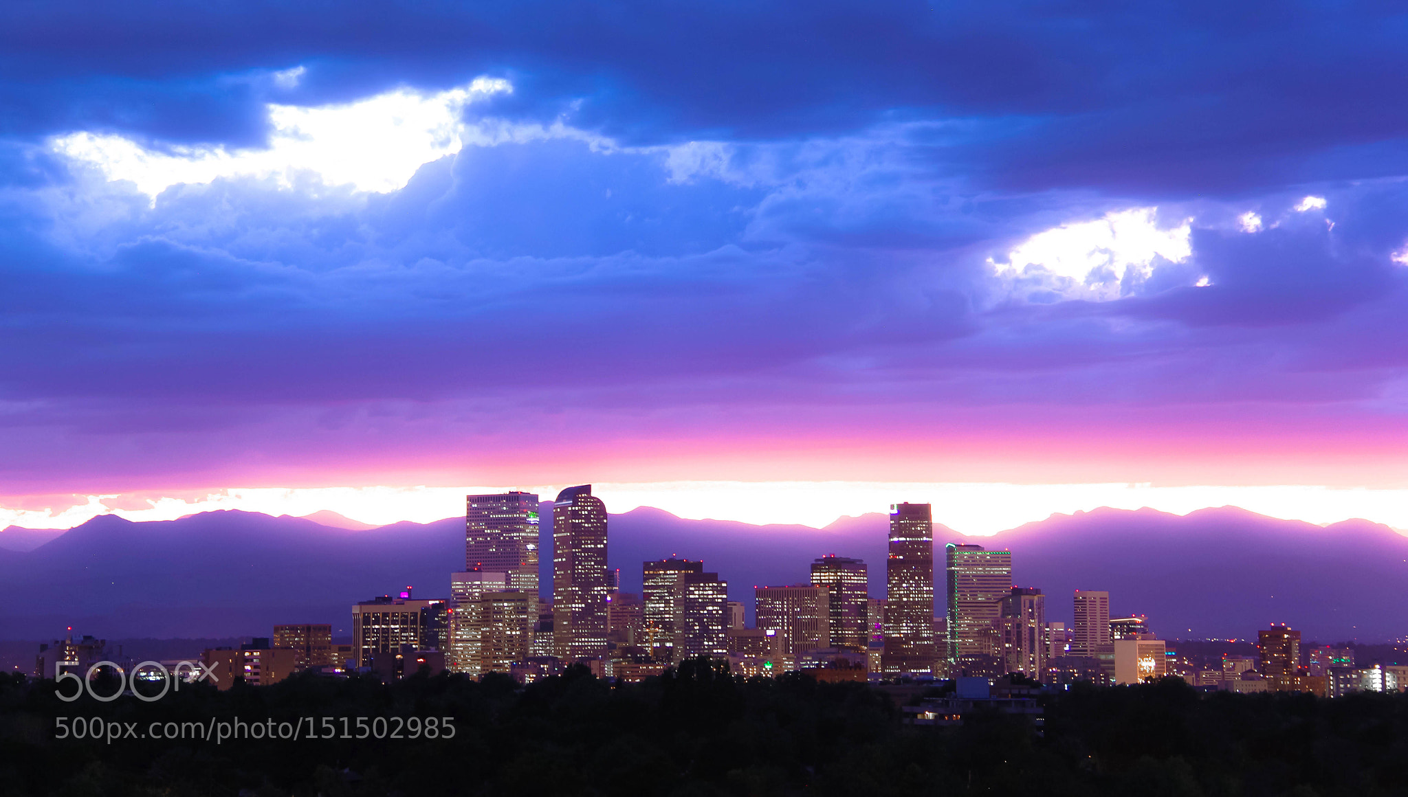 Neon lavender clouds above Denver