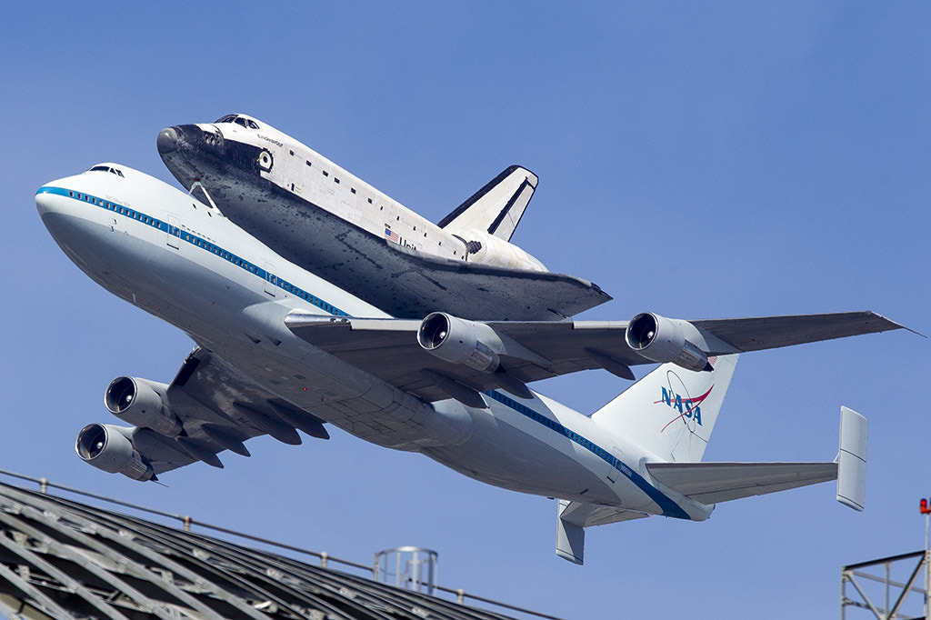 Photograph Space Shuttle Endeavour OV105 on top of a Boeing 747 Shuttle Carrier Aircraft (SCA) N905NA by Elliot Lowe on 500px