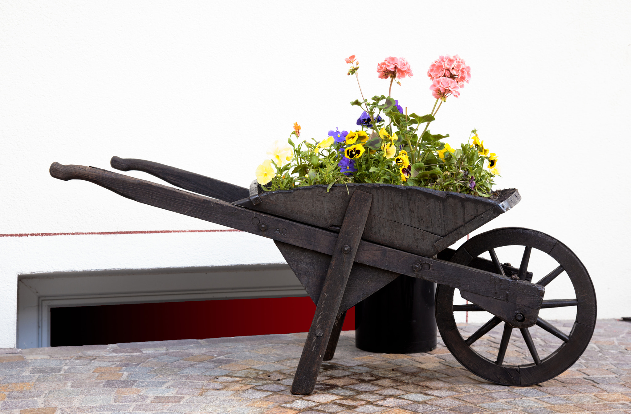 Photograph Wheelbarow With Flowers by Uri Baruch on 500px