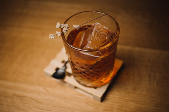 Whiskey drink with  ice  on  wood in bar by Brian Wilson on 500px